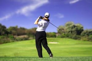 golfer teeing off c